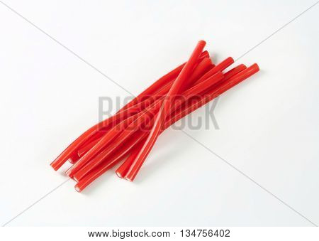 strawberry candy sticks on white background