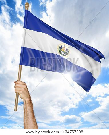 Person's hand holding the El Salvador national flag and waving it in the sky, 3D rendering