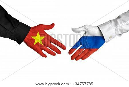 Vietnam and Russia leaders shaking hands on a deal agreement