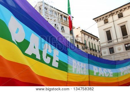 rainbow peace flag during a demonstration of peace activists in an Italian square