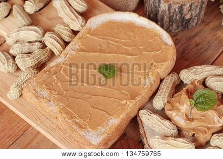 Peanut butter smeared on bread is delicious