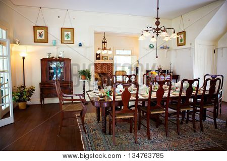 FORT MYERS, FL-APRIL  15 2016: Fort Myers Florida, Thomas Edison and Henry Ford Winter Estates. Main Ford estate house museum. Antique dining room.