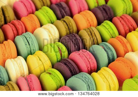 Colorful sweet macaroons with warming color filter.