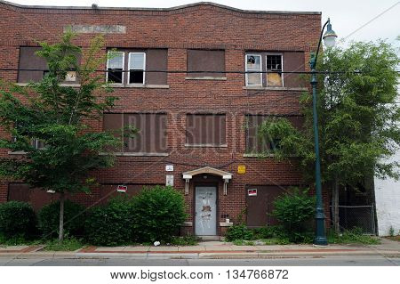 JOLIET, ILLINOIS / UNITED STATES - MAY 24, 2015: The McCracken building sits vacant and abandoned in downtown Joliet.