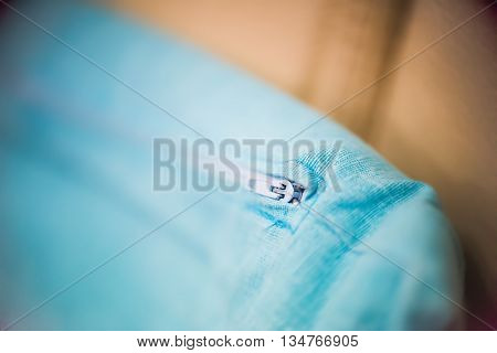 close up of a turquoise pillow zipper