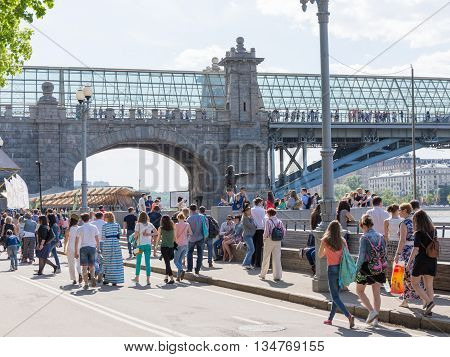 Moscow - May 9 2016: Glass Pushkin foot bridge and a lot of people and tourists in the beautiful Gorky Park May 9 2016 Moscow Russia
