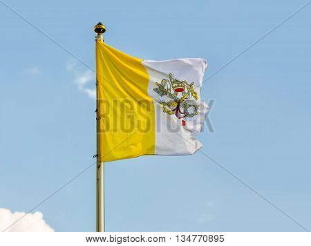 Vatican Flag Against Blue Sky