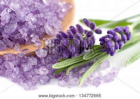 Wooden spoon with lavender bath salt isolated on white