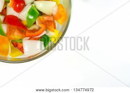 split tomatoes onion and sweet pappers in bowl