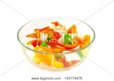 split tomatoes onion and sweet papper in bowl