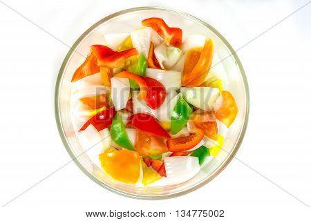 split tomatoes, onion, sweet, sweet papper in bowl