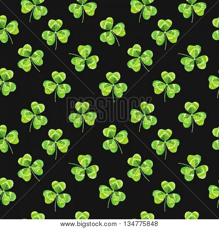 Seamless floral pattern with flowers on a black background. Floral pattern with watercolor realistic leaves.
