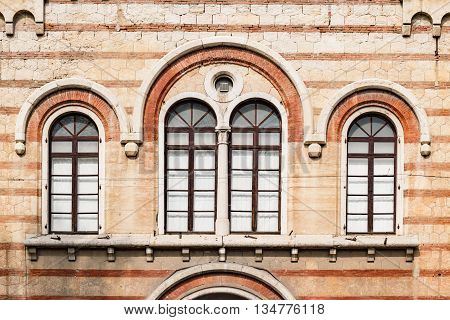 Old medieval arched windows in Romanesque style.