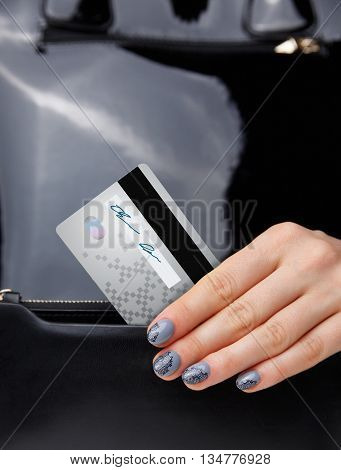 Closeup of a credit card in a woman's hand