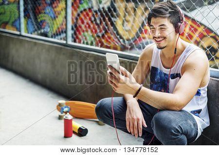 Urban Skater Listening Music Concept