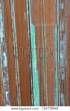Old wood paneling stipped of green paint.