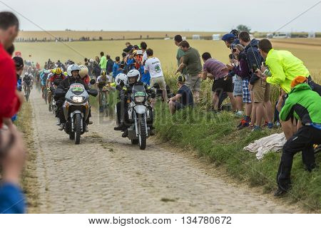 Quievy, France - July 07 2015: Two official bikes forego in front of the peloton on a cobblestone road during the stage 4 of Le Tour de France 2015 in Quievy France on 07 July2015.
