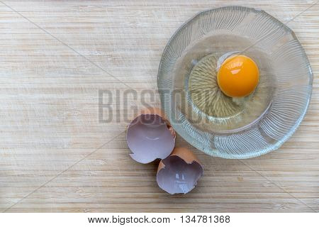 Egg In A Bowl On The Wooden Chopping Board And Egg Shell By Side Ready To Be Cooked A Delicious Egg
