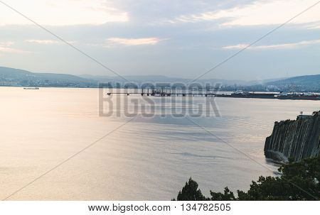 Novorossiysk, Russia, on August 22, 2015. Sea vessels in the Novorossiysk bay at evening light. View on the city and port.