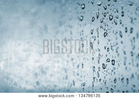 Closeup of a rain or water drops on a window glass