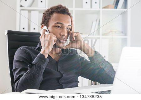 Focused Black Man On Phone