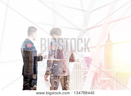Two businessmen discussing business contract on New York city background. Double exposure
