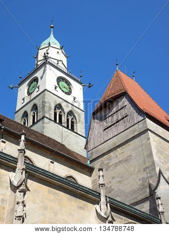 Detail of Minster St. Nikolaus in Ueberlingen at Lake Constance, Germany. Taken in vertical format against blue sky.