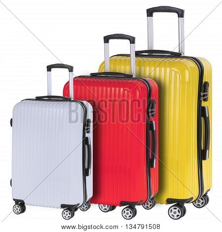 Three suitcases red white and yellow isolated on white background