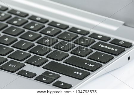 Close up of the keyboard in the prestigious silver laptop