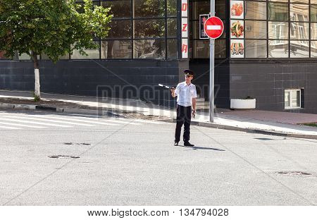 SAMARA RUSSIA - JUNE 12 2016: Russian policeman of the State Automobile Inspectorate at the city street in summer day