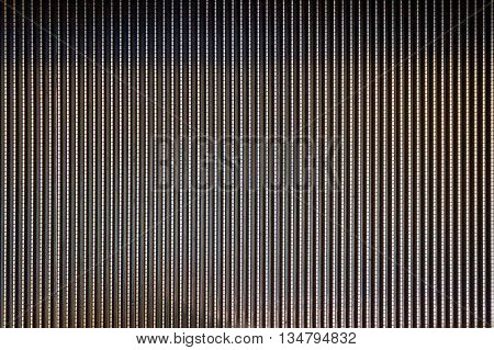 Abstract background texture of striped pattern of metal escalator foot step