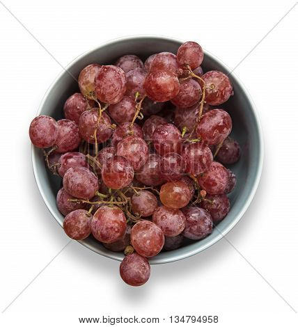 Bowl of red grapes isolated on white