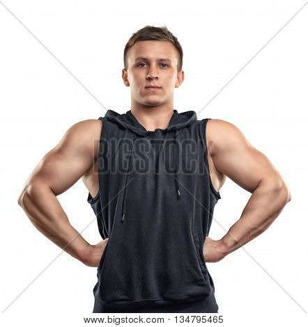 Waist-up portrait of handsome muscled young man posing for the camera. Self improvement. Body power and beauty. Healthy lifestyle. Fitness and sport. Power of body.