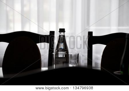 Abstract profile image transparent water bottle a glass and a back seat