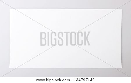 horizontal single white sheet of paper on a gray background