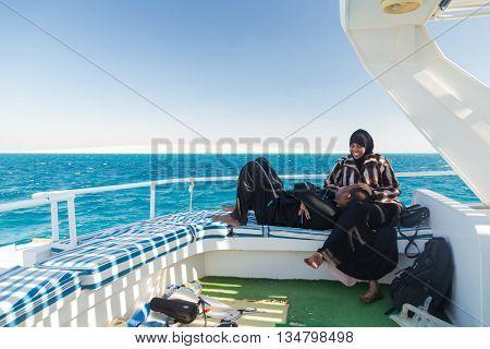 PARADISE ISLAND, EGYPT - FEBRUARY 12: Tourists couple on dive boat going snorkeling on Paradise Island.