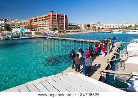 PARADISE ISLAND, EGYPT - FEBRUARY 12: Tourists waiting in line for dive boat to go snorkeling on Paradise Island.