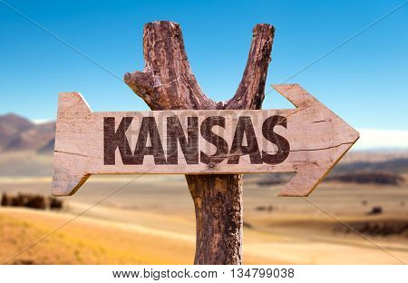 Kansas wooden sign with a desert background