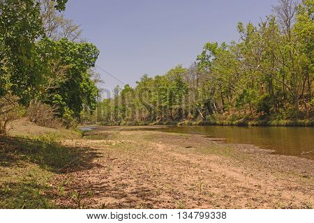 Burburi river at Low Water in by Kanha National Park in India