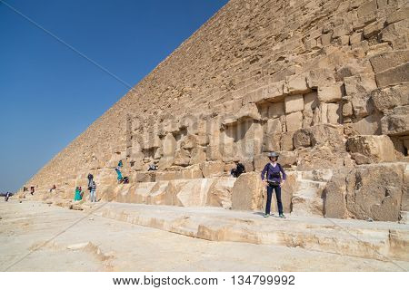 CAIRO, EGYPT - FEBRUARY 3, 2016: Tourists around The Great Pyramid of Giza, Egypt.