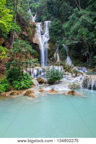 Kuang Si Waterfall near Luang Prabanh Laos. This beautiful waterfall is a popular place to cool of in the hot country of Laos.