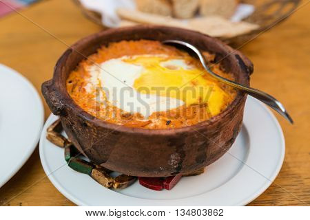 Bowl of shakshuka, popular Egyptian meal.