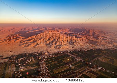 View from hot air balloon over the Valley of the Kings and Nile river.
