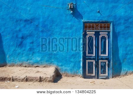 Blue doors on typical colourful house in Luxor, Egypt.