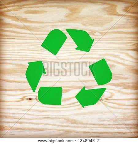 wooden texture with recycle symbol. The recycle symbol on background