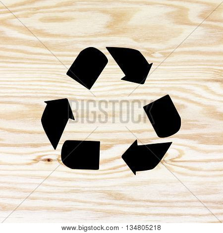The wooden texture with recycle symbol. recycle symbol on plywood background