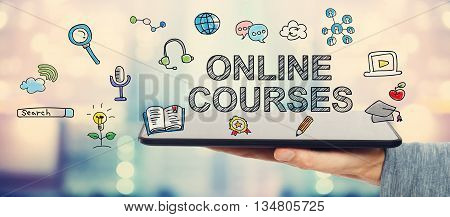 Online Courses Concept With Man Holding Tablet