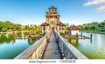 An old water palace in the east of Bali with a bridge over the pools to the main building where royalty lived in the past & still own to this day.
