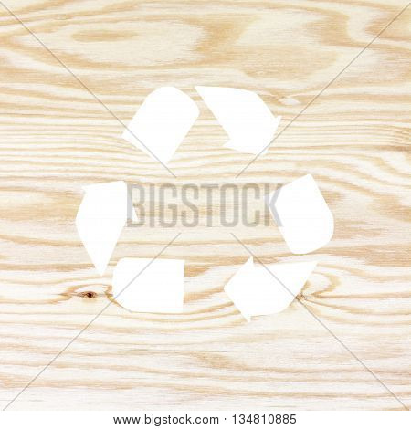 The wooden texture with recycle symbol. recycle symbol on plywood