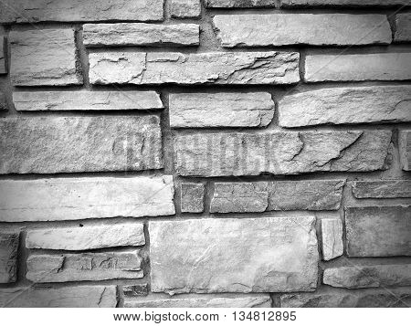uneven cracked stone wall texture background in balck and white